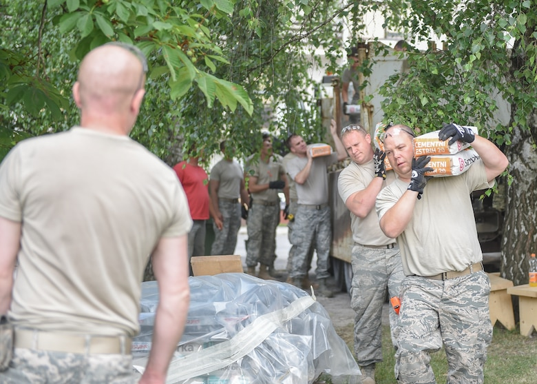 Soldiers of the Minnesota Army National Guard 851st Vertical Engineer Company, Airmen from the Minnesota Air National Guard 148th Fighter Wing and 133rd Airlift Wing Civil Engineering Squadrons along with the Croatian Army Engineering Horizontal Construction Company work together for repairs and to rebuild parts of a primary school in Karlovac, Croatia on June 9, 2016.  The project is a Humanitarian Civic Assistance project made possible by the US European Command in partnership with the US Embassy in Zagreb, Croatia.