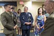 Air Force Chief of Staff Gen. Mark A. Welsh III, center, his wife Betty Welsh, and their son, Marine Corps 1st Lt. Matthew Welsh, left, chat with Marine Corps Gen. Joe Dunford, chairman of the Joint Chiefs of Staff, before Welsh's retirement ceremony at Joint Base Andrews, Md., June 24, 20156. Welsh became chief of staff in August 2012. DoD photo by Navy Petty Officer 2nd Class Dominique A. Pineiro