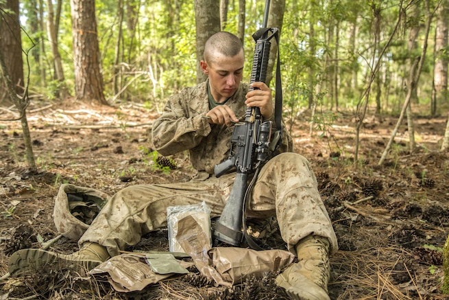 Marine Corps recruit Tyler Steeley cleans his weapon during the Crucible at Marine Corps Recruit Depot Parris Island, S.C., June 24, 2016. Marine Corps photo by Lance Cpl. Colby Cooper