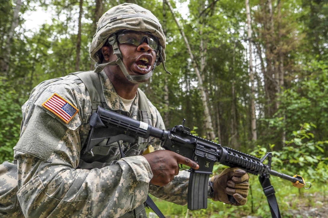 Army Spc. Gerald Wilson yells a warning about incoming indirect fire to his team during the Ready Warrior Competition at Camp Madbull on Joint Base Elmendorf-Richardson, Alaska, June 23, 2016.  The three-day competition tested teams' physical fitness, small-arms proficiency, land navigation and small-unit tactics. Air Force photo by Justin Connaher