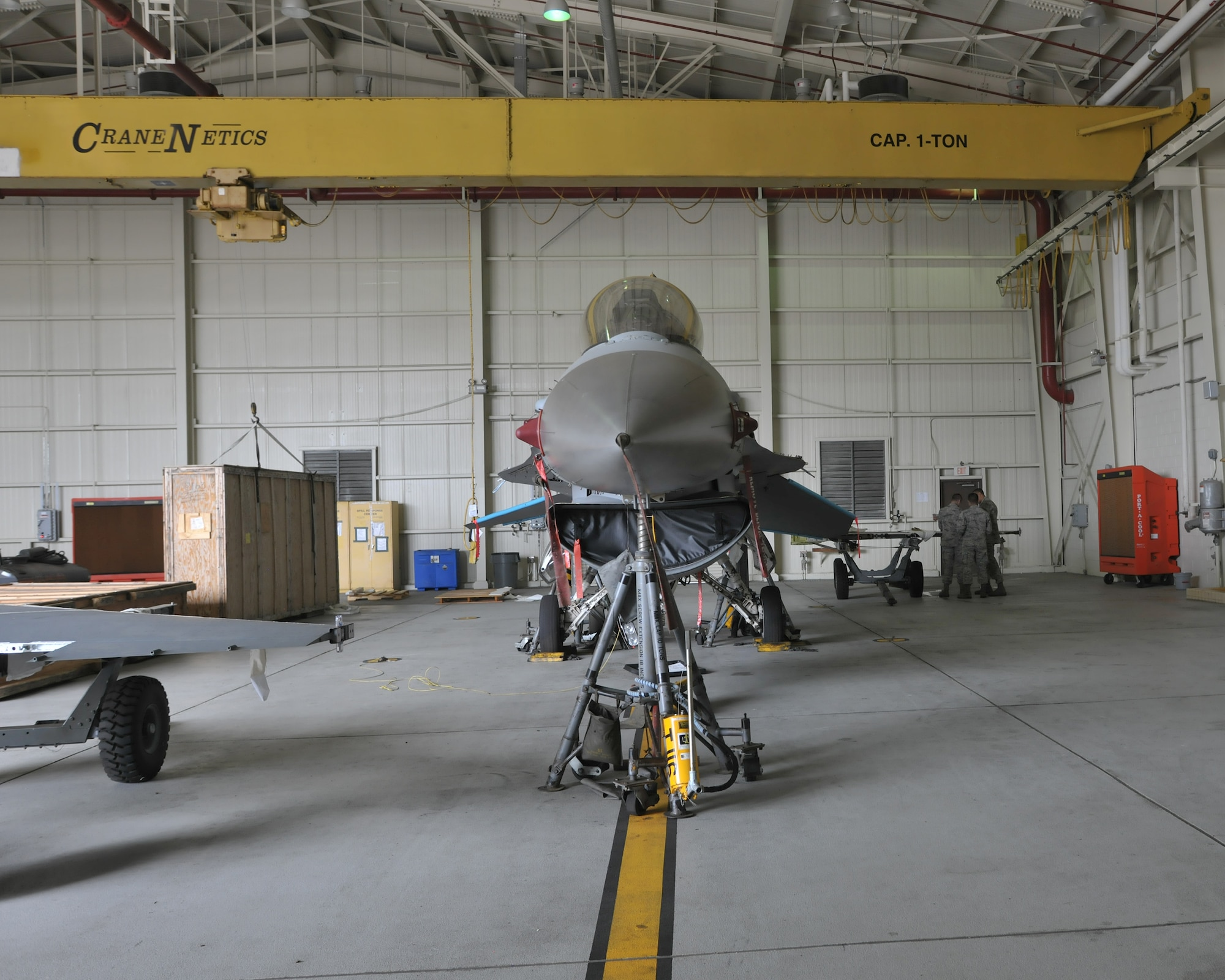 An 8th Fighter Wing F-16 undergoes a simultaneous double-wing replacement at Kunsan Air Base, Republic of Korea, June 24, 2016. This procedure requires crew chiefs and maintainers from aircraft fuels systems, aircraft armament systems and aircraft structural maintenance working in harmony to ensure the replacement of the wings is done correctly and the aircraft is returned to duty. (U.S. Air Force photo/Master Sgt. David Miller)