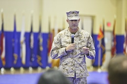 Brig. Gen. Francis L. Donovan the incoming commander, task force (CTF) 51 and commander, 5th Marine Expeditionary Brigade (5th MEB), address the audience at the change of command ceremony held at Naval Support Activity Bahrain. Donovan relieved Maj. Gen. Carl E. Mundy, III as commander of the blue-green team.