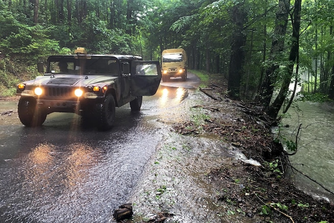 Soldiers drive vehicles along roadways to conduct damage assessments from flooding in Allegheny County, Va., June 24, 2016. National Guard soldiers and airmen assisted with response efforts following severe flooding in Virginia and West Virginia. Army National Guard photo by Alfred Puryear