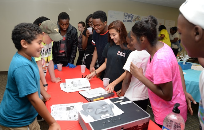 """Twenty-seven teens attend a five-day summer program at Marine Corps Logistics Base Albany, recently. Teen C.A.R.R.O.L.L. University facilitators taught youth skills designed to help shape their day-to-day activities as well as their future choices and career goals. The acronym for Teen C.A.R.R.O.L.L. University, """"Caring, Aspiring, Revolutionary, Radiant, Outstanding, Lively, Learning,"""" set the stage for a series of interactive work sessions participants experienced throughout the week."""