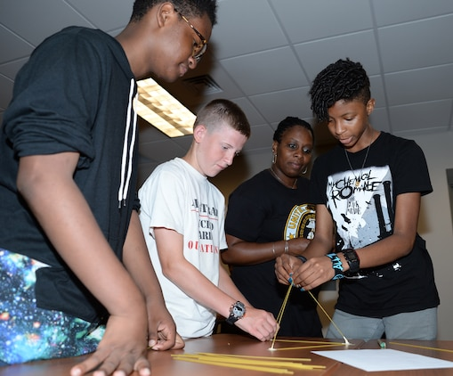 Marine Corps Logistics Base Albany youth and teens build a project using spaghetti noodles, 36-inches of tape and one marshmallow during the first annual Teen C.A.R.R.O.L.L. University summer camp here, June 15. Teen C.A.R.R.O.L.L. University facilitators taught youth skills designed to help shape their day-to-day activities as well as their future choices and career goals.