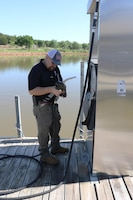 Jason Person, environmental specialist for the U.S. Army Corps of Engineers Tulsa District, inspects a gas pump at a marina on Kaw Lake during an Environmental Review Guide for Operations or ERGO, May 10, 2016.  Person is the lone environmental specialist for Tulsa Districts Northern Area, a huge area of land covering approximately 15,000 square miles and 13 USACE projects. (USACE photo by Thomas Mills/Released)