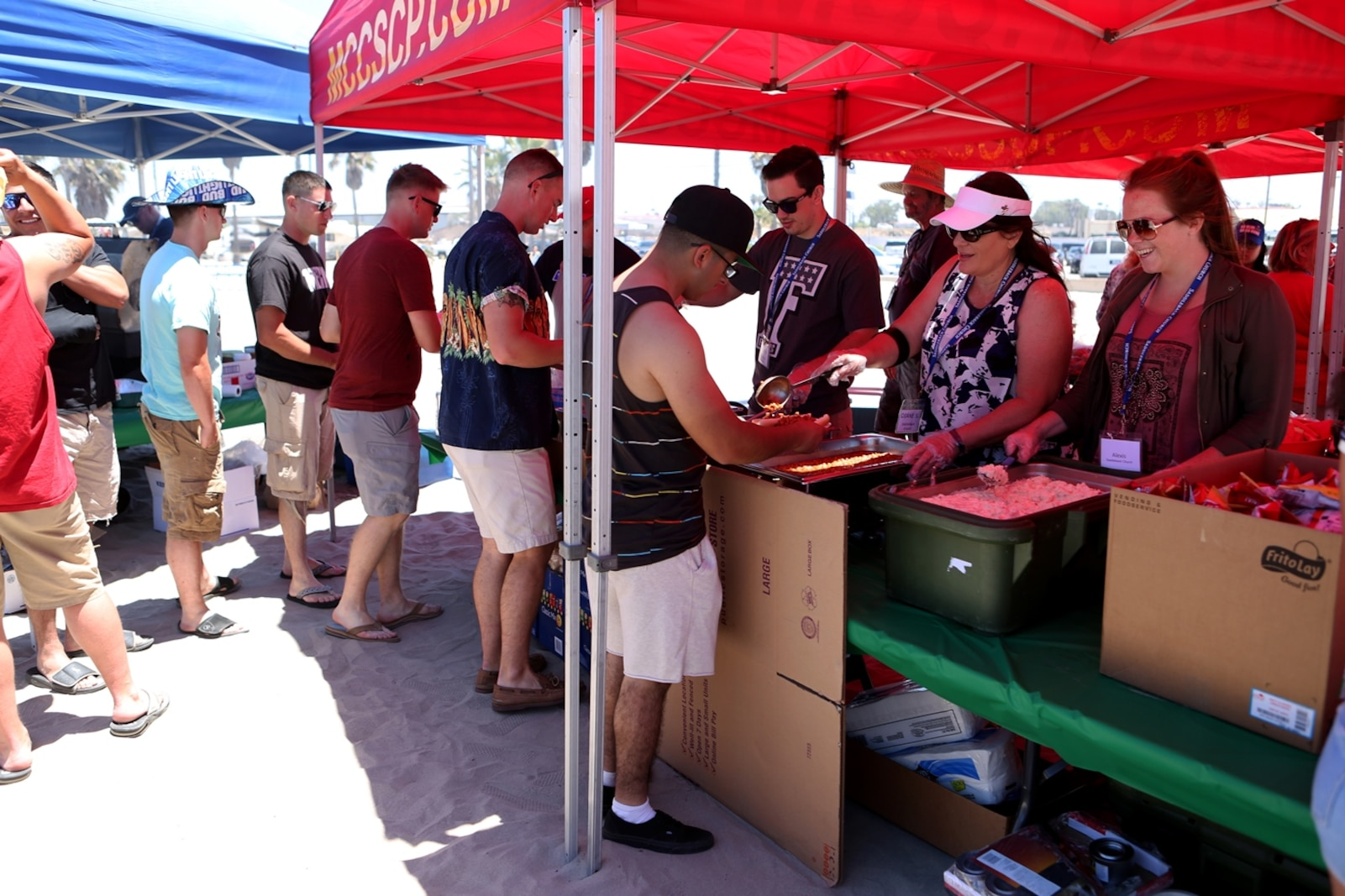 Marines, Sailors and family members of Combat Logistics Battalion 5, 1st Marine Logistics Group, enjoy food, fun, and festivities hosted by volunteers from Saddleback Church and Marine Corps Camp Services aboard Camp Pendleton, Calif., June 17, 2016. Aside from offering service members and their families some time to come together and relax, the event supported the 101 Days of Summer Campaign, which aims to promote increased safety during the summer months. (U.S. Marine Corps Photos by Sgt. Carson Gramley/released)