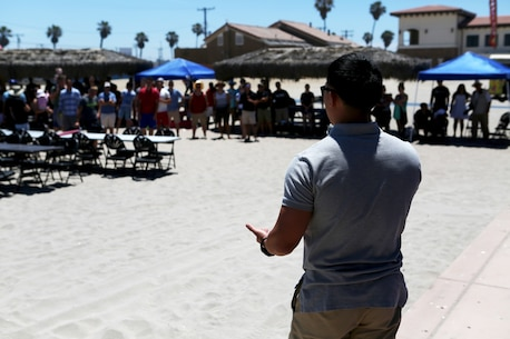 U.S. Marine Capt. Samuel Kang addresses Marines, Sailors and family members of Combat Logistics Battalion 5, 1st Marine Logistics Group, at a family appreciation event hosted by volunteers from Saddleback Church and Marine Corps Camp Services aboard Camp Pendleton, Calif., June 17, 2016. Kang is the executive officer, acting, for CLB-5. Aside from offering service members and their families some time to come together and relax, the event supported the 101 Days of Summer Campaign, which aims to promote increased safety during the summer months. (U.S. Marine Corps Photos by Sgt. Carson Gramley/released)