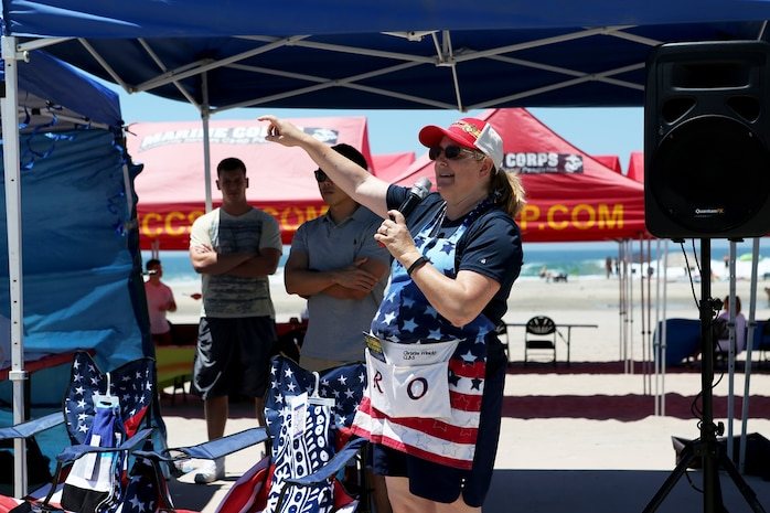 Christine Winicki addresses Marines, Sailors and family members of Combat Logistics Battalion 5, 1st Marine Logistics Group, at a family appreciation event hosted by volunteers from Saddleback Church and Marine Corps Camp Services aboard Camp Pendleton, Calif., June 17, 2016. Winicki is the Battalion family readiness officer. Aside from offering service members and their families some time to come together and relax, the event supported the 101 Days of Summer Campaign, which aims to promote increased safety during the summer months. (U.S. Marine Corps Photos by Sgt. Carson Gramley/released)