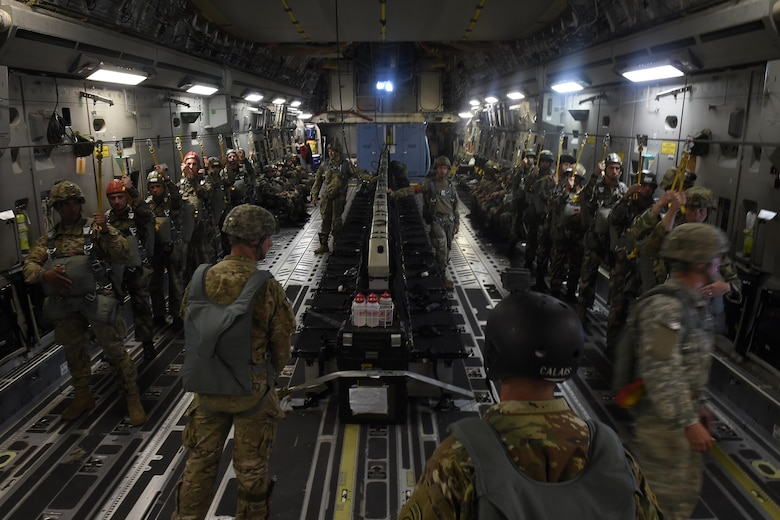 82nd Airborne Division and French paratroopers prepare to conduct a static-line jump from a 62nd Airlift Wing C-17 Globemaster III June 22, 2016, near Libreville, Gabon Africa during exercise Central Accord 2016. U.S. Army Africa's exercise Central Accord 2016 is an annual, combined, joint military exercise that brings together partner nations to practice and demonstrate proficiency in conducting peacekeeping operation. (U.S. Air Force photo/Tech. Sgt. Tim Chacon)