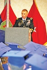 Brig. Gen. Patrick D. Frank, deputy commanding general for support, 1st Infantry Division, speaks to graduates during the combined graduation ceremony at the Courtyard by Marriott and Geary County Convention Center in Junction City, Kansas, May 19.