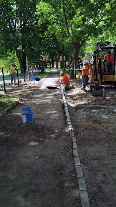 Resetting the granite blocks delineating the stone dust pathway along the Fenway roadway. Note the installation of the temporary landscape protection fencing in the location of the construction access gate, which will no longer be used.