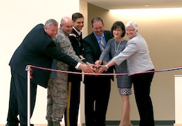 Dignataries cut the ribbon on the new Hanscom Middle School.
