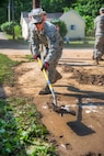 Air Force Tech. Sgt. Caleb Brown shovels mud and debris during flood cleanup in Clendenin, W.Va., June 26, 2016. Brown is assigned to the West Virginia Air National Guard's 130th Airlift Wing. Air National Guard photo by Tech. Sgt. De-Juan Haley