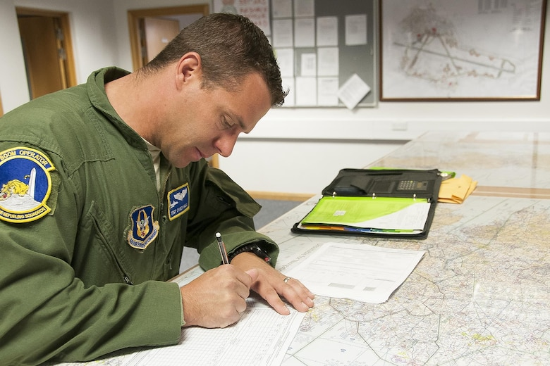 Technical Sgt. Casey Hall, 756th Air Refueling Squadron boom operator, fills out paperwork prior to a refueling mission at Royal Air Force Base Mildenhall, England, June 13, 2016. Boom operators play an integral role in pre-flight preparation and are responsible for fuel delivery from 459th Air Refueling Wing's KC-135R Stratotankers to various receivers. Members of the 459th ARW, to include pilots, boom operators and maintainers, are in England from mid-June to late July to help provide training and refueling support for Operation Atlantic Resolve. OAR aims to ensure peace and stability in Eastern Europe in the wake of Russia's intervention in Ukraine.  (U.S. Air Force photo/Staff Sgt. Kat Justen)