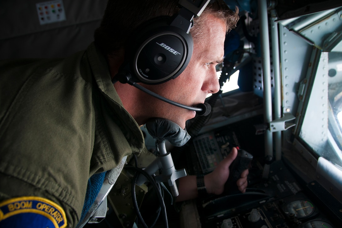 Technical Sgt. Casey Hall, 756th Air Refueling Squadron boom operator, looks out of a boom pod window during a refueling mission over Norway June 13, 2016. Boom operators play an integral role in pre-flight preparation and are responsible for fuel delivery from 459th Air Refueling Wing's KC-135R Stratotankers to various receivers. Members of the 459th ARW, to include pilots, boom operators and maintainers, are in Europe from mid-June to late July to help provide training and refueling support for Operation Atlantic Resolve. OAR aims to ensure peace and stability in Eastern Europe in the wake of Russia's intervention in Ukraine. (U.S. Air Force photo/Staff Sgt. Kat Justen)