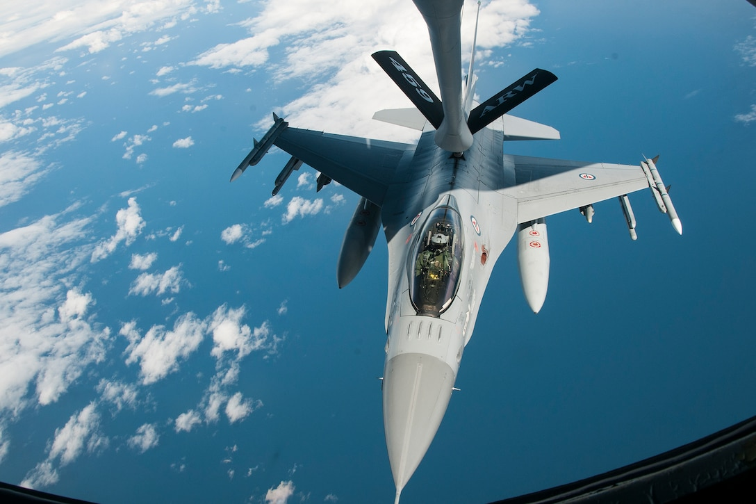 A Norwegian Air Force F-16 is refueled by a 459th Air Refueling Wing KC-135R Stratotanker over Norway June 13, 2016. Members of the 459th ARW, to include pilots, boom operators and maintainers, are in Europe from mid-June to late July to help provide training and refueling support for Operation Atlantic Resolve. OAR aims to ensure peace and stability in Eastern Europe in the wake of Russia's intervention in Ukraine.  (U.S. Air Force photo/Staff Sgt. Kat Justen)