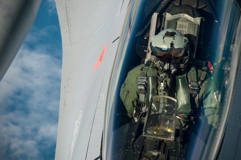 A Norwegian Air Force F-16 pilot waits for his aircraft to receive fuel from a 459th Air Refueling Wing KC-135R Stratotanker over Norway June 13, 2016. Members of the 459th ARW, to include pilots, boom operators and maintainers, are in Europe from mid-June to late July to help provide training and refueling support for Operation Atlantic Resolve. OAR aims to ensure peace and stability in Eastern Europe in the wake of Russia's intervention in Ukraine.  (U.S. Air Force photo/Staff Sgt. Kat Justen)