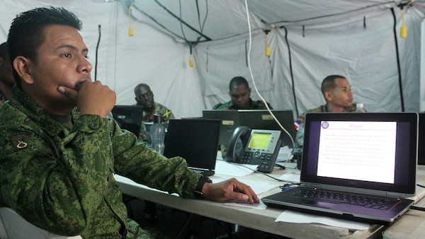 Capt. Edwin Oliva, executive officer of Operations, Belize Defense Force, listens to a brief on Command and Control during Phase II of exercise Tradewinds 2016, at Up Park Camp, Jamaica, June 24, 2016.  Tradewinds 2016 is a Chairman of the Joint Chiefs of Staff-approved, U.S. Southern Command-sponsored combined joint exercise conducted in conjunction with 17 partner nations to enhance the collective ability of their defense forces and constabularies to counter transnational organized crime and conduct humanitarian/disaster relief operations, while developing strong relationships and reinforcing human rights awareness.