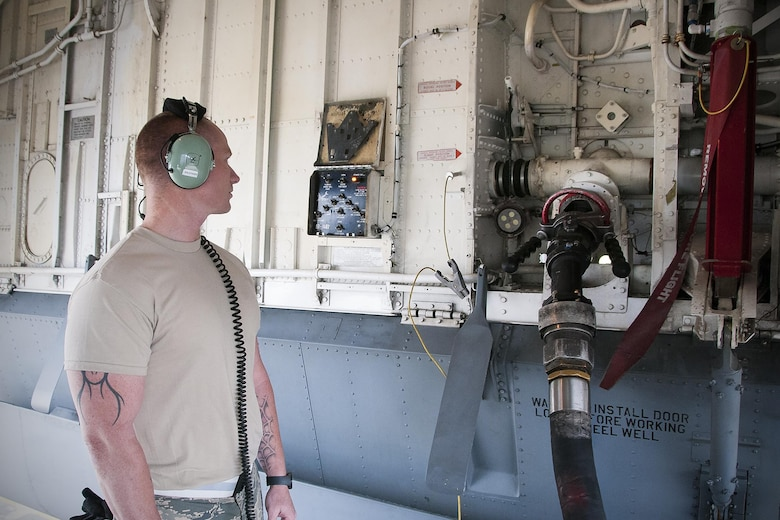 Master Sgt. Steven Lessard, 459th Aircraft Maintenance Squadron refueling supervisor, monitors fuel delivery to a KC-135R Stratotanker on the Royal Air Force Base Mildenhall, England, flight line June 13, 2016. Maintainers play an integral role in pre-flight preparation and are responsible for ensuring the fleet of 459th Air Refueling Wing aircraft are fit for flight. Members of the 459th ARW, to include pilots, boom operators and maintainers, are in England from mid-June to late July to help provide training and refueling support for Operation Atlantic Resolve. (U.S. Air Force photo/Staff Sgt. Kat Justen)