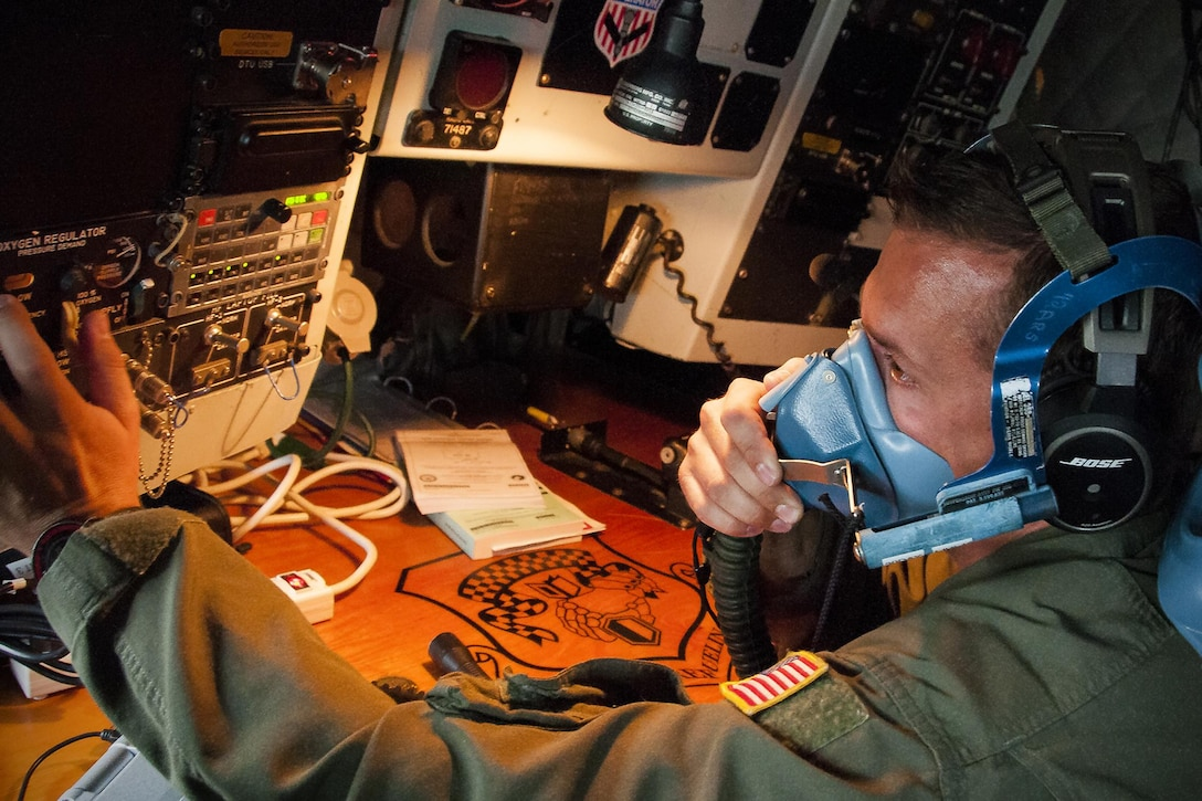 Technical Sgt. Casey Hall, 756th Air Refueling Squadron boom operator, checks an oxygen mask for proper function inside the cockpit of a KC-135R Stratotanker on the Royal Air Force Base Mildenhall, England, flight line June 13, 2016, prior to a refueling mission with the Norwegian Air Force. Members of the 459th Air Refueling Wing, to include pilots, boom operators and maintainers, are in England from mid-June to late July to help provide training and refueling support for Operation Atlantic Resolve. (U.S. Air Force photo/Staff Sgt. Kat Justen)