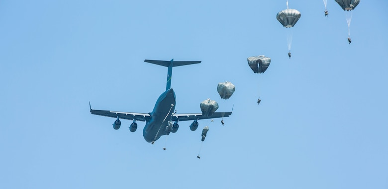 U.S. Army paratroopers, from the 82nd Airborne Infantry Division, jump out of a C-17 Globemaster III during exercise Central Accord 2016 in Gabon, June 20, 2016. The U.S. Army Africa exercise is an annual, combined, joint military exercise that brings together partner nations to practice and demonstrate proficiency in conducting peacekeeping operations. (U.S. Army photo/Spc. Audrequez Evans)