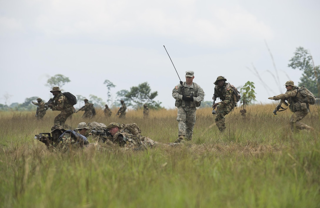 A U.S. Army infantryman and a Cameroonian armed forces soldier work alongside one another to secure a checkpoint during a simulated tactical movement at exercise Central Accord 2016 in Libreville, Gabon, June 21, 2016. The U.S. Army Africa exercise is an annual, combined, joint military exercise that brings together partner nations to practice and demonstrate proficiency in conducting peacekeeping operations. (DOD  photo/Tech. Sgt. Brian Kimball)