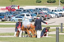 "A crew from ""Hamilton's Own"" — 1st Battalion, 5th Field Artillery, 1st Armored Brigade Combat Team, 1st Infantry Division — fires a ceremonial cannon to indicate the start of June 6's 100th Anniversary Committee Charter Ceremony. To kick off preparations for the 100th anniversary of the 1st Inf. Div. in 2017, leaders from the local communities and the ""Big Red One"" and state politicians gathered at Fort Riley to sign a charter outlining the goals of the observance."