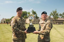 "Command Sgt. Maj. Billy Ray Counts II, 97th Military Police Battalion senior noncommissioned officer, and Lt. Col. Alexander Murray, commander of the 97th MP Bn., celebrate after being awarded the 2016 Victory Cup, during the Victory Week awards ceremony June 10 at Custer Hill Parade Field. The ""Guardians"" accumulated the most points from sporting events."