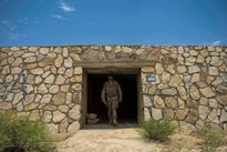 Air Force Staff Sgt. Gary Allsbrook exits an old bunker at Bagram Airfield, Afghanistan, June 27, 2016. Members of the 455th Expeditionary Security Forces Squadron quick reaction force check buildings and other areas on the flightline to deter threats. Air Force photo by Senior Airman Justyn M. Freeman
