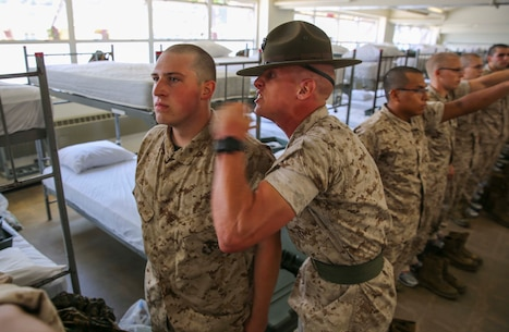 Sergeant Stephen M. Powers, drill instructor, Charlie Company, 1st Recruit Training Battalion, corrects a recruit for not following directions during pick up at Marine Corps Recruit Depot San Diego, June 24. From this point forward, drill instructors will be with their recruits every day until graduation day and are responsible for transforming them from civilian to Marine. Annually, more than 17,000 males recruited from the Western Recruiting Region are trained at MCRD San Diego. Charlie Company is scheduled to graduate Sept. 16.