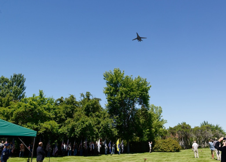 A B-1 Lancer from the 28th Bomb Wing at Ellsworth Air Force Base, S.D., performs a slow-speed flyover in honor of Staff Sgt. David J. Thatcher June 27, 2016, in Missoula, Mont. At 20 years old, and as an engineer gunner in Flight Crew 7 of the Doolittle Tokyo Raids, Thatcher's crew crash-landed into sea off the coast of China April 18, 1942. Thatcher saved four members of the crew by pulling them to safety on the surrounding beach and applying life-saving medical treatment, even though he was injured himself. (U.S. Air Force photo by 2nd Lt. Annabel Monroe)
