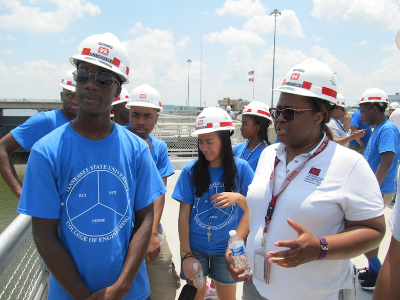 Tenesse Henderson, an electrical engineer from the Nashville District talks with students from the Tennessee State University NSTI program at the Old Hickory Lock, June 22, 2016. The students are attending the Tennessee State University Engineering Department's four-week National Summer Transportation Institute program.