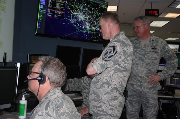 Chief Master Sgt. of the Air Force James Cody, center, visited the Western Air Defense Sector May 4.  Cody received a first hand tour of the WADS operations floor and learned how members of the unit identify, detect and defend against airborne threats over the western portion of the continental U.S.