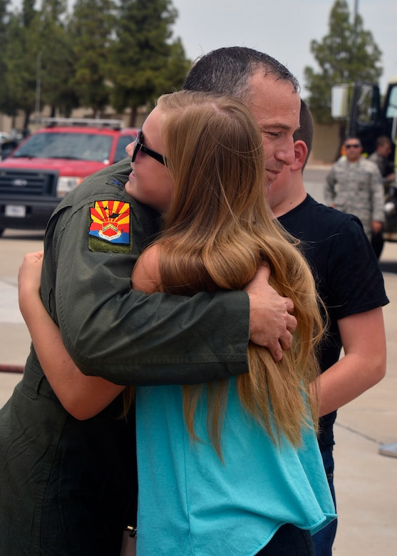 Brig. Gen. Scott Pleus, 56th Fighter Wing commander, receives a hug from his daughter after his final flight in an F-35 Lightning II June 27, 2016 at Luke Air Force Base, Ariz. His two-year tenure as commander was filled with change as the wing shifted its mission to include the F-35.(U.S. Air Force photo by Senior Airman Devante Williams)