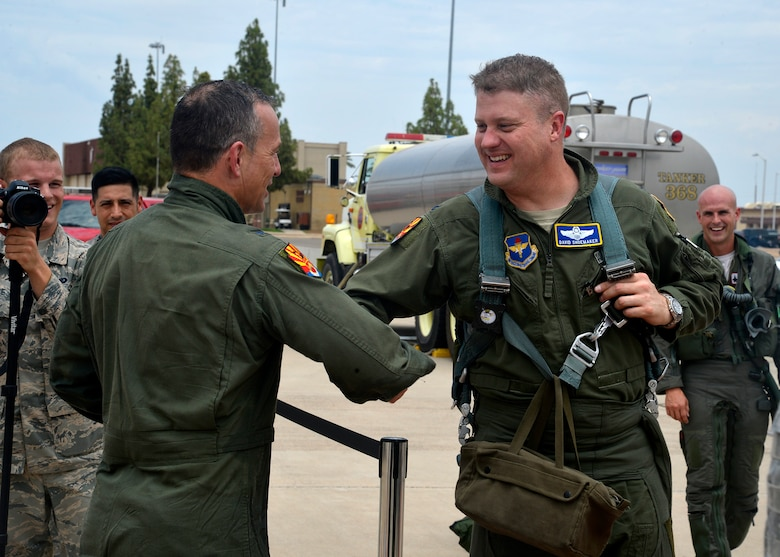 Brig. Gen. Scott Pleus, 56th Fighter Wing commander, is congratulated by Col. David Shoemaker, 56th Fighter Wing vice commander, after his final flight in an F-35 Lightning II June 27, 2016 at Luke Air Force Base, Ariz. His two-year tenure as commander was filled with change as the wing shifted its mission to include the F-35. (U.S. Air Force photo by Senior Airman Devante Williams)