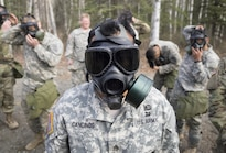 Army Staff Sgt. Henry Cancinos conducts chemical, biological, radiological and nuclear defense training at Joint Base Elmendorf-Richardson, Alaska, April 13, 2016. The training culminated with masked soldiers entering a sealed chamber filled with tear gas and then removing their protective gear to promote confidence in their equipment. Cancinos is assigned to the 25th Infantry Division's Bravo Troop, 1st Squadron (Airborne), 40th Cavalry Regiment. Air Force photo by Justin Connaher