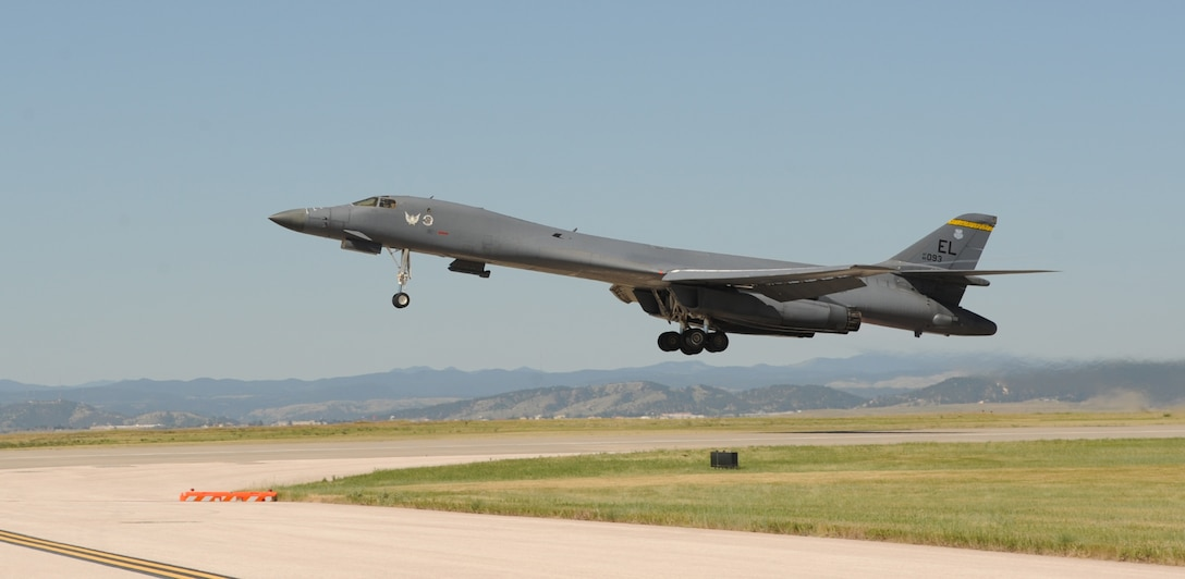 """A B-1 bomber takes off From Ellsworth Air Force Base, S.D., to perform a flyover in honor of U.S. Army Air Corps Staff Sgt. David Thatcher, June 27, 2016. Thatcher was the engineer gunner of a B-25 medium-range bomber on Crew #7, """"The Ruptured Duck,"""" during the Doolittle Raid on April 18, 1942. (U.S. Air Force photo by Airman 1st Class Denise M. Nevins/Released)"""