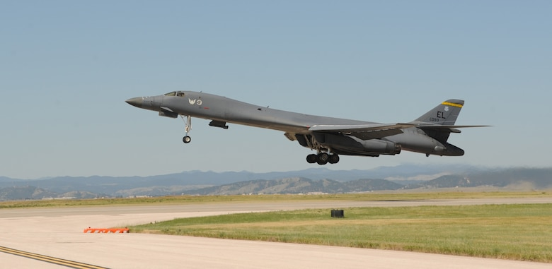 "A B-1 bomber takes off From Ellsworth Air Force Base, S.D., to perform a flyover in honor of U.S. Army Air Corps Staff Sgt. David Thatcher, June 27, 2016. Thatcher was the engineer gunner of a B-25 medium-range bomber on Crew #7, ""The Ruptured Duck,"" during the Doolittle Raid on April 18, 1942. (U.S. Air Force photo by Airman 1st Class Denise M. Nevins/Released)"