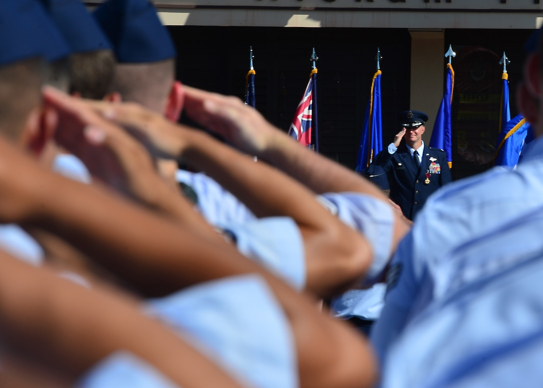 Colonel Randall Huiss, 15th Wing commander, receives his final salute from the Airmen of the 15th Wing as commander, during the 15th Wing Change of Command Ceremony on Joint Base Pearl Harbor-Hickam, June 27, 2016. During the ceremony, Huiss, former 15th Wing commander, relinquished command to Col. Kevin Gordon, 15th Wing Commander. Gordon became the 72nd commander of the 15th Wing following the ceremony today.  (U.S. Air Force photo by Tech. Sgt. Aaron Oelrich/Released)