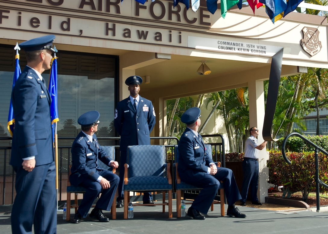 Master Sgt. Norman Leblanc, 647 Civil Engineering Squadron, unveils a plaque during the 15th Wing Change of Command Ceremony on Joint Base Pearl Harbor-Hickam, June 27, 2016.  The plaque, located on the operations building, signifies the responsibilities of the 15th Wing Commander, Col. Kevin Gordon. Gordon became the 72nd commander of the 15th Wing following the ceremony today. (U.S. Air Force photo by Tech. Sgt. Aaron Oelrich/Released)