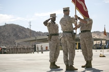 Lt. Col. Lee Rush, right, passes the battalion's colors to Lt. Col. Christopher Meyers, left, during 1st Tank Battalion's change of command ceremony at the tank ramp, June 22, 2016. The passing of the battalion colors symbolizes the passing of command and responsibilities from the outgoing to the on-coming commanding officer. (Official Marine Corps photo by Cpl. Thomas Mudd/Released)