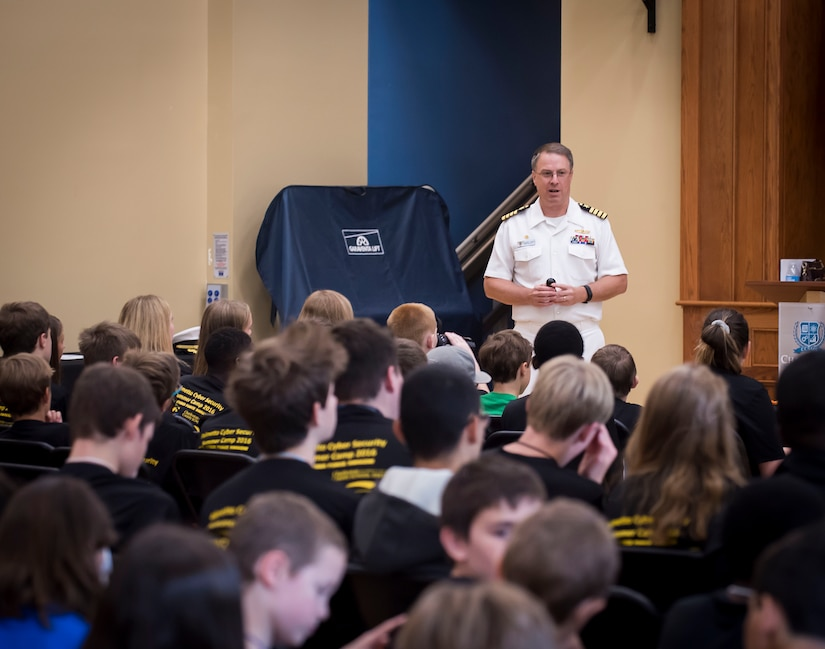 SPAWAR Systems Center (SSC) Atlantic commanding officer Scott Heller speaks to more than 80 middle school students attending the SSC Atlantic sponsored cybersecurity summer camp at the Lowcountry Tech Academy of Charleston County in Charleston, S.C. During the week long camp over 30 volunteers from SSC Atlantic exposed and challenged the students in cyber espionage, computer deconstruction, command and control systems, internet security, snap circuits and scratch programming among other activities. (U.S. Navy photo/Joe Bullinger)