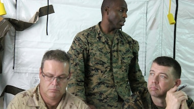 Gunnery Sgt. Sasha Chandler, intelligence analyst, briefs military officers participating in the command and control training of Phase II during exercise Tradewinds 2016, at Up Park Camp, Jamaica, June 24, 2016. Tradewinds includes both maritime and land phases, which will further enhance opportunities for participating countries to improve their security and disaster assistance capabilities.