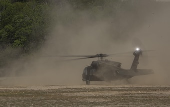 A UH-60 Blackhawk hastily lands to begin casualty evacuation drills during Exercise Tradewinds 2016, at Twickenham Park Gallery Range, Jamaica, June 23, 2016. Tradewinds is designed to conduct joint, combined and interagency participating nation capacity building focuses on increasing regional cooperation in complex multinational security operations and humanitarian assistance.