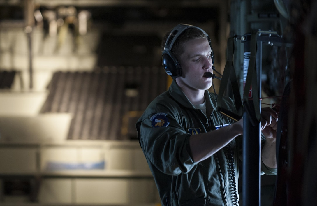 Senior Airman Alec Miller, a loadmaster with the 96th Airlift Squadron, secures a strap in a C-130H Hercules prior to releasing cargo during exercise Central Accord 2016 in Libreville, Gabon, June 18, 2016. The U.S. Army Africa exercise is an annual, combined, joint military exercise that brings together partner nations to practice and demonstrate proficiency in conducting peacekeeping operations. (DOD photo/Tech. Sgt. Brian Kimball)