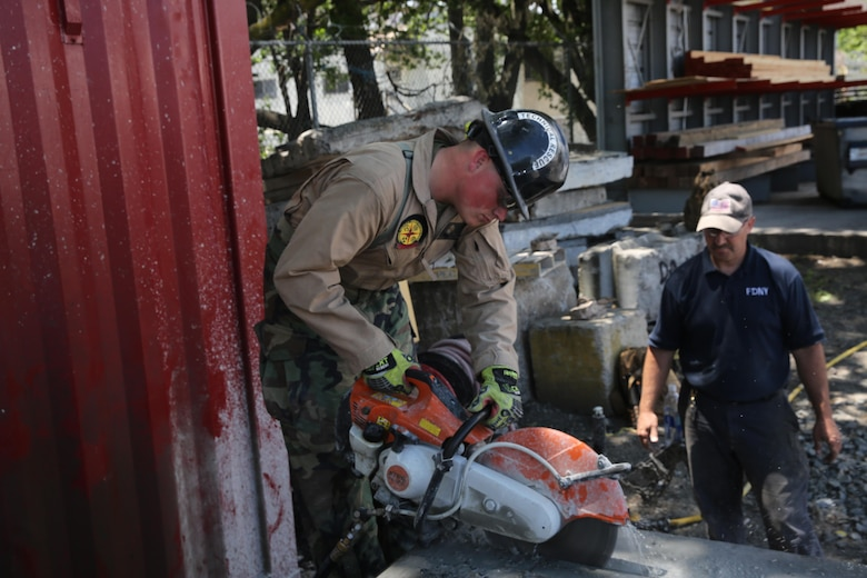 Marines and Sailors with Chemical Biological Incident Response Force train alongside the Fire Department of New York for a field training exercise at the F.D.N.Y. training academy in Randall's Island, N.Y. June 20, 2016. CBIRF is an active duty Marine Corps unit that, when directed, forward-deploys and/or responds with minimal warning to a chemical, biological, radiological, nuclear or high-yield explosive (CBRNE) threat or event in order to assist local, state, or federal agencies and the geographic combatant commanders in the conduct of CBRNE response or consequence management operations, providing capabilities for command and control; agent detection and identification; search, rescue, and decontamination; and emergency medical care for contaminated personnel. (Official USMC Photo by Lance Cpl. Maverick S. Mejia/RELEASED)