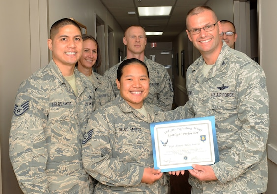 Tech. Sgt. Aimee Delos Santos, 22nd Aerospace Medicine Squadron optometry NCO in-charge, poses with Col. Phil Hesseltine, 22nd Air Refueling Wing vice commander, June 7, 2016, at McConnell Air Force Base, Kan. Delos Santos received the spotlight performer for the week of May 9-13. (U.S. Air Force photo/Senior Airman David Bernal Del Agua)