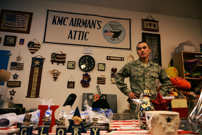 Senior Airman Nigel Lee, 86th Logistics Readiness Squadron traffic management office member, works at the Airman's Attic checkout desk at Ramstein Air Base, Germany, June 24, 2016. The Airman's Attic is sponsored by the Kaiserslautern Military Community Top 3 organization. (U.S. Air Force Photo/ Airman 1st Class Joshua Magbanua)