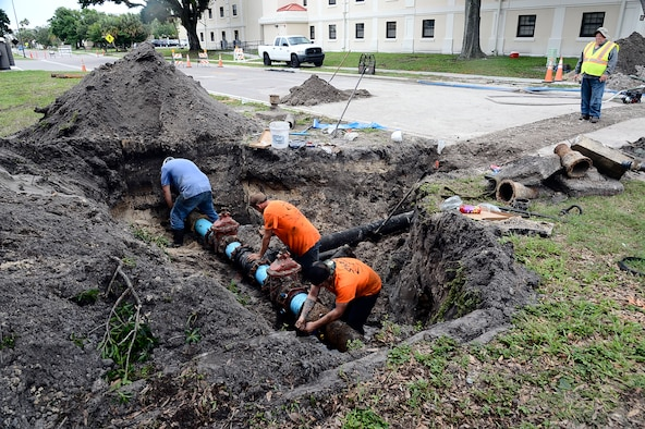 Contractors fix a broken water main by replacing an old pipe with a new one at MacDill Air Force Base, Fla. June 10, 2016. They replaced the pipe with a new section of eight-inch ductile iron piping across the entire road and other needed piping connections were installed to correct the damage.